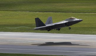 FILE - In this Aug. 14, 2012 file photo, a U.S. Air Force F-22 Raptor stealth fighter takes off from Kadena Air Base on the southern island of Okinawa in Japan. In its first months of combat in the skies above Iraq and Syria in 2015, the F-22 has been more of an escort role, using its high-tech sensors and communications to guide and protect other fighters that are actually dropping the bombs. (AP Photo/Greg Baker, File)