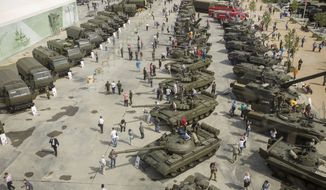 man and machine: Tanks and other vehicles greet visitors at Patriot Park in Moscow. As military themes make inroads into Russian recreation, fashionable wedding parties are joining the trend by using armored personnel carriers. (Getty Images)