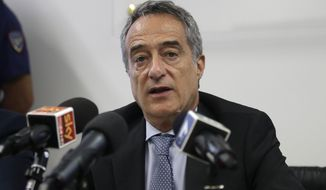 Prosecutor Maurizio Romanelli talks during a news conference to illustrate an anti-terrorism operation, at the Police headquarters in Milan, Italy, Wednesday, July 22, 2015. Italian prosecutors say two men behind a Twitter account that carried threats in the name of the Islamic State group were targeting an Italian military base near Brescia that has a U.S. military presence. (AP Photo/Antonio Calanni) ** FILE **