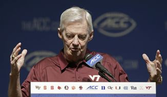 Virginia Tech coach Frank Beamer responds to questions during the ACC NCAA college football kickoff in Pinehurst, N.C., Tuesday, July 21, 2015. (AP Photo/Gerry Broome)
