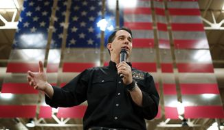 FILE - In this July 14, 2015, file photo, Republican presidential candidate Wisconsin Gov. Scott Walker speaks during a campaign event at a Harley-Davidson dealership in Las Vegas. Walker is scheduled to address an annual showcase of conservative activists, Thursday, July 23, in San Diego. (AP Photo/John Locher, File)