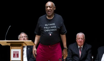 In this June 4, 2014, file photo, entertainer and former classmate Bill Cosby speaks as Patrick O'Connor, chairman of Temple University's Board of Trustees, right, listens during a public memorial service for Philadelphia Inquirer co-owner Lewis Katz at Temple University in Philadelphia. (AP Photo/Matt Rourke, File)