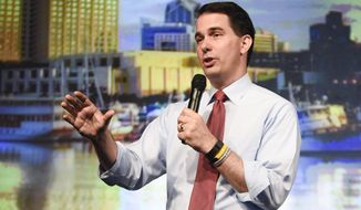 Wisconsin Gov. Scott Walker, a Republican presidential candidate, waves after speaking at the American Legislative Exchange Council 42nd annual meeting in San Diego on July 23, 2015. (Associated Press) **FILE**