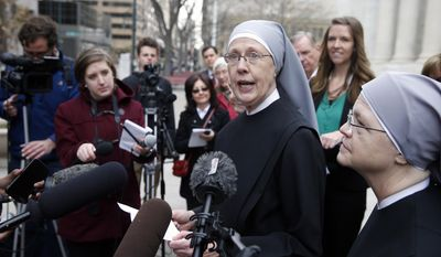 In this Dec. 8, 2014, file photo, Sister Loraine Marie Maguire, of Little Sisters of the Poor, speaks to members of the media after attending a hearing in the 10th U.S. Circuit Court of Appeals, in Denver, Colo. (AP Photo/Brennan Linsley, file)
