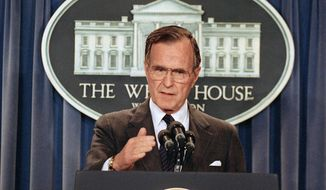"""President George H.W. Bush infamously went back on his 1988 """"no new taxes"""" campaign pledge, but he is far from the only politician to do so. (Associated Press)"""