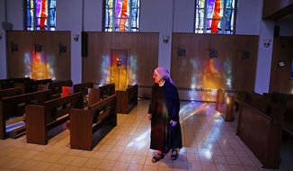 Mother Patricia Mary walks in the chapel at the Mullen Home for the Aged, run by Little Sisters of the Poor, in Denver on Jan. 2, 2014. (Associated Press) **FILE**