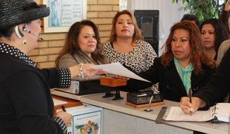 Parents and supporters of a petition to convert traditional Palm Lane Elementary School in Anaheim, California, to a charter school. (Photo anaheimblog.net)