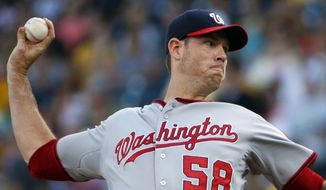 Washington Nationals starting pitcher Doug Fister delivers during the first inning of a baseball game against the Pittsburgh Pirates in Pittsburgh, Thursday, July 23, 2015. (AP Photo/Gene J. Puskar)