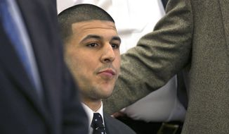 Former New England Patriots football player Aaron Hernandez listens as the guilty verdict is read during his murder trial at the Bristol County Superior Court in Fall River, Mass., on April 15, 2015. (Dominick Reuter/Pool Photo via Associated Press) **FILE**
