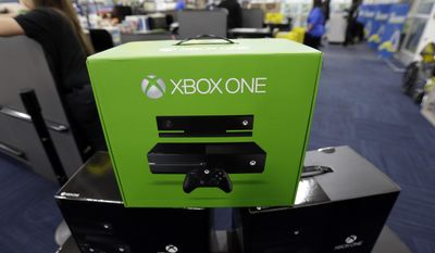 In this Nov. 22, 2013, file photo, Xbox Ones are on display at a Best Buy store in Evanston, Ill. (AP Photo/Nam Y. Huh, File)