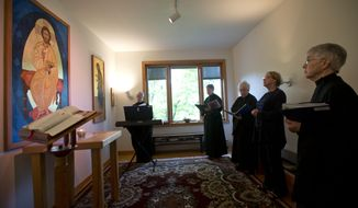 In this Thursday, July 16, 2015 photo, sisters at New Skete Monastery, and a guest, take part in morning prayers in Cambridge, N.Y. The nuns of New Skete lead a cloistered life marked by prayer, contemplation and baking cheesecakes. The small group of self-reliant nuns in upstate New York have long sold cheesecakes online, continuing a centuries-old tradition of monastic orders producing fine foods to pay expenses. (AP Photo/Mike Groll)
