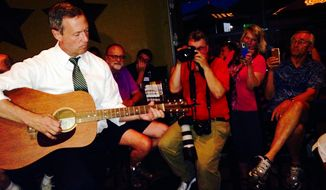 Democratic presidential hopeful Martin O'Malley plays guitar at a bar Friday, July 24, 2015, in the Beaverdale section of Des Moines, Iowa, a sought after Democratic neighborhood that actively supported President Barack Obama's re-election. (AP Photo/Catherine Lucey_