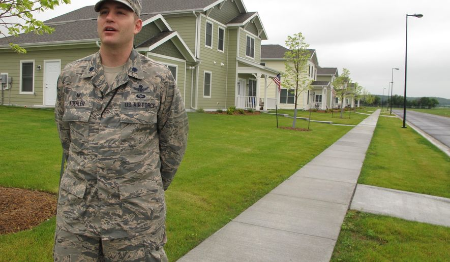 Lt. Col. John Koehler, commander of the Cavalier Air Force Station, is pictured on Thursday, July 16, 2015, in front of a new housing unit for base family members. The project includes 14 houses at a cost of about $225,000 each. It's part of a major facelift for the northeastern North Dakota base. (AP Photo/Dave Kolpack)