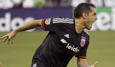 DC United's Fabian Espindola celebrates after scoring a goal against the Columbus Crew during the first half of an MLS soccer game, Saturday, May 2, 2015, in Washington. (AP Photo/Luis M. Alvarez)