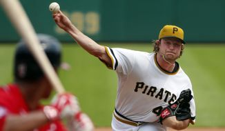 Pittsburgh Pirates starting pitcher Gerrit Cole, right, delivers to Washington Nationals' Wilson Ramos during the sixth inning of a baseball game in Pittsburgh, Sunday, July 26, 2015. Cole became the majors' first 14-game winner, leading the Pirates to a 3-1 victory. (AP Photo/Gene J. Puskar)