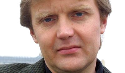 "In this Friday, May 10, 2002, file photo, Alexander Litvinenko, former KGB spy and author of the book ""Blowing Up Russia: Terror From Within"" is photographed at his home in London. A prime suspect in the killing of Alexander Litvinenko says he won't testify as planned at an inquiry into the former Russian spy's death, leading the judge in charge to accuse him of trying to manipulate proceedings.  (AP Photo/Alistair Fuller, File)"