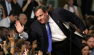 New Jersey Gov. Chris Christie speaks to supporters during an event announcing he will seek the Republican nomination for president at Livingston High School in Livingston, N.J. (AP Photo/Julio Cortez)