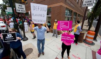 Opponents and supporters of Planned Parenthood demonstrated Tuesday July 28, 2015, in Philadelphia. Pro-life activist, who are horrified by recent undercover videos from Center for Medical Progress about fetal organ harvesting and distribution, are calling for an end to government funding for Planned Parenthood. (Associated Press/Matt Rourke/File)