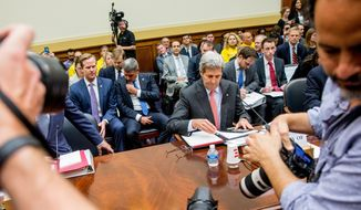 Secretary of State John Kerry prepares to testify on Capitol Hill in Washington, Tuesday, July 28, 2015, before the House Foreign Affairs Committee hearing on the Iran Nuclear Agreement. (AP Photo/Andrew Harnik)
