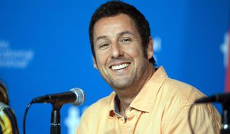 "In this Sept. 6, 2014 file photo, actor Adam Sandler smiles during a news conference for ""Men, Women, and Children"" at the 2014 Toronto International Film Festival in Toronto. Sandler will star in ""The Ridiculous Six"", which premieres on Dec. 11 on Netflix. The movie is one of four he will star in and produce for Netflix.  (Hannah Yoon/The Canadian Press via AP, File)"