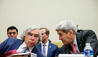 Energy Secretary Ernest Moniz (left) and Secretary of State John Kerry talk on Capitol Hill in Washington on July 28, 2015, prior to testifying before the House Foreign Affairs Committee hearing on the Iran Nuclear Agreement. (Associated Press)