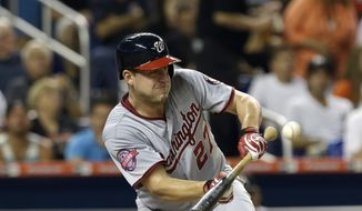 Washington Nationals' Jordan Zimmermann bunts a pop out to Miami Marlins pitcher Jose Fernandez in the fifth inning of a baseball game, Tuesday, July 28, 2015, in Miami. (AP Photo/Alan Diaz)