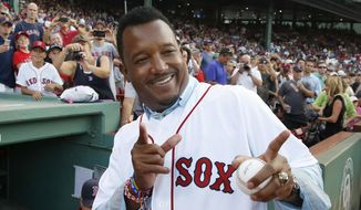 Former Boston Red Sox great Pedro Martinez gestures as he leaves the field following a ceremony conducted in Spanish to honor him after his induction into the Baseball Hall of Fame, before a baseball game between the Red Sox and the Chicago White Sox in Boston, Wednesday, July 29, 2015. (AP Photo/Michael Dwyer) ** FILE **