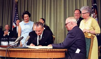 President Johnson signs Medicare legislation July 30, 1965.                Associated Press photo