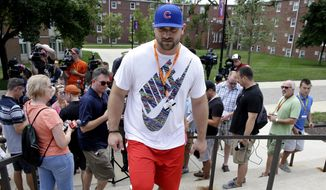 Chicago Bears guard Kyle Long leaves an NFL football training camp media availability at Olivet Nazarene University, Wednesday, July 29, 2015, in Bourbonnais, Ill. (AP Photo/Nam Y. Huh)