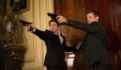 """In this image released by Paramount Pictures, Tom Cruise, left, and Jeremy Renner appear in a scene from """"Mission: Impossible - Rogue Nation."""" (David James/Paramount Pictures and Skydance Productions via AP)"""