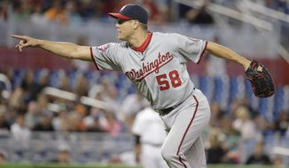 Washington Nationals closing pitcher Jonathan Papelbon reacts when Michael Morse strikes out for the final out in the ninth inning of a baseball game, Thursday, July 30, 2015, in Miami. The Nationals defeated the Marlins 1-0. (AP Photo/Lynne Sladky)
