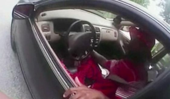 In this July 19, 2015, frame from body camera video provided by the University of Cincinnati Campus Police, university Officer Ray Tensing stands next to motorist Samuel DuBose during a traffic stop for a missing front license plate in Cincinnati. DuBose was fatally shot by the officer after a struggle ensued when he refused to provide a driver's license and get out of the car. Tensing was indicted Wednesday, July 29 on a murder charge. (University of Cincinnati Campus Police via AP)