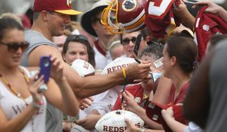 Washington Redskins outside linebacker Ryan Kerrigan signs autographs for fans during the teams NFL football training camp in Richmond, Va., Thursday, July 30, 2015.  (AP Photo/Jason Hirschfeld)