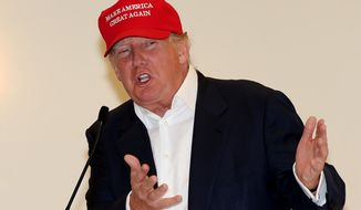 Presidential contender Donald Trump speaks to the media during a press conference on the 1st first day of the Women's British Open golf championship on the Turnberry golf course in Turnberry, Scotland, Thursday, July 30, 2015. (AP Photo/Scott Heppell)