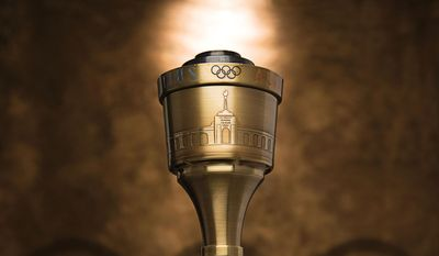 FILE - In this undated file photo provided by Heritage Auctions, the 1984 Summer Olympics torch that Bruce Jenner carried through Lake Tahoe, Nevada is shown. The 24-inch torch, featuring a brass finish and wood handle, is on the auction block at Heritage Auctions during their evening sale Thursday,  July 30, 2015, in Chicago. It is the first significant piece of Jenner memorabilia to go to auction since the winner of the 1976 Olympic Decathlon Gold Medal became Caitlyn Jenner. (Heritage Auctions via AP)