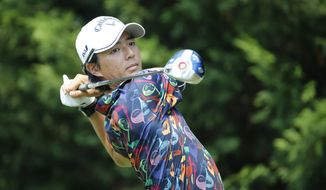 Ryo Ishikawa, of Japan, watches his tee shot on the third hole during the first round of the Quicken Loans National golf tournament at the Robert Trent Jones Golf Club in Gainesville, Va., Thursday, July 30, 2015. (AP Photo/Steve Helber)