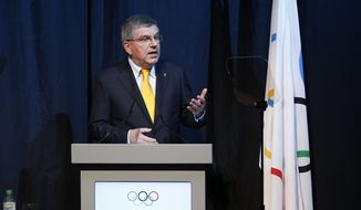 President of the International Olympic Committee (IOC) Thomas Bach, speaks during the opening ceremony of IOC in Kuala Lumpur, Malaysia, Thursday, July 30, 2015. (AP Photo/Vincent Thian)