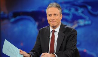 "This Nov. 30, 2011, file photo shows television host Jon Stewart during a taping of ""The Daily Show with Jon Stewart"" in New York. Stewart signed off for good on Aug. 6. (AP Photo/Brad Barket, File)"