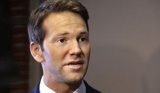 Former U.S. Rep. Aaron Schock speaks to members of the media in Peoria, Ill., in this Feb. 6, 2015, file photo. (AP Photo/Seth Perlman, File)