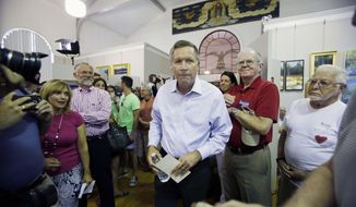 Republican presidential candidate, Ohio Gov. John Kasich arrives for a town hall meeting at the Historical Society of Cheshire County, Friday, July 31, 2015, in Keene, N.H. (AP Photo/Jim Cole)