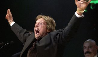Wrestler Rowdy Roddy Piper gestures to the crowd after being inducted into the WWE Hall of Fame at the Induction Ceremony in Universal City, Calif., in this April 2, 2005, file photo. The WWE said Piper died Friday, July 31, 2015. He was 61. (AP Photo/Matt Sayles, File)