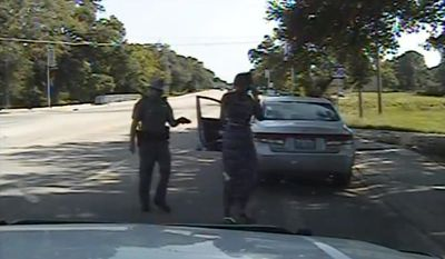 In this July 10, 2015, file frame from dashcam video provided by the Texas Department of Public Safety, Trooper Brian Encinia arrests Sandra Bland after she became combative during a routine traffic stop in Waller County, Texas. (Texas Department of Public Safety via AP, File)