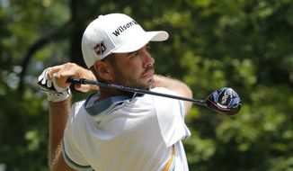 Troy Merritt watches his tee shot on the 15th hole during the third round of the Quicken Loans National golf tournament at the Robert Trent Jones Golf Club in Gainesville, Va., Saturday, Aug. 1, 2015.  (AP Photo/Steve Helber)