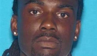 Tremaine Wilbourn in seen in this undated photo released by the Memphis Police Department. According to authorities, Wilbourn is a suspect in the fatal shooting of Memphis Police Officer Sean Bolton during a traffic stop, Saturday, Aug. 1, in Memphis, Tenn. (Memphis Police Department via Associated Press)