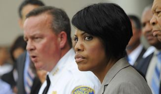 Baltimore Mayor Stephanie Rawlings-Blake and other elected officials announce the start of the Baltimore Federal Homicide Task Force, Monday, Aug. 3, 2015, in Baltimore. Baltimore police and civic leaders launched a partnership Monday with five federal agencies that will embed their special agents with city homicide detectives, bidding to quell an upswing in homicides and other violent crime in that city. (Lloyd Fox/The Baltimore Sun via AP)