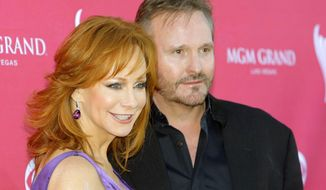 FILE - In this April 5, 2009 file photo,  Reba McEntire, left, and Narvel Blackstock arrive at the 44th Annual Academy of Country Music Awards in Las Vegas. McEntire and Blackstock announced Monday, Aug. 3, 2015, they are separating after 26 years of marriage. The two announced in a joint statement that they have worked together for 35 years and will continue to do so.  (AP Photo/Jae C. Hong, File)