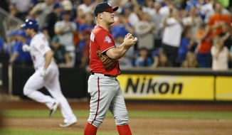 Washington Nationals starting pitcher Jordan Zimmermann, right, looks toward the outfield after allowing back-to-back home runs, this one to New York Mets Daniel Murphy, who trots the bases during the third inning of a baseball game in New York, Sunday, Aug. 2 2015. (AP Photo/Kathy Willens)