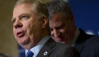 Seattle Mayor Ed Murray, left, joined New York Mayor Bill de Blasio, speaks during a news conference with fellow mayors on immigration reform, Friday, Jan. 23, 2015, at the U.S. Conference of Mayors' 83rd Winter Meeting in Washington. (AP Photo/Pablo Martinez Monsivais)