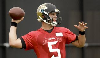Jacksonville Jaguars quarterback Blake Bortles throws a pass during practice at NFL football training camp, Saturday, Aug. 1, 2015, in Jacksonville, Fla. (AP Photo/John Raoux)