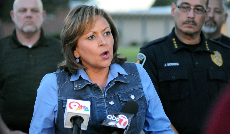 Gov. Susana Martinez speaks to reporters about the two explosive devices that were detonated on Sunday morning at Holy Cross Catholic Church and Calvary Baptist Church, Sunday, Aug. 2, 2015. (Robin Zielinski/Las Cruces Sun-News via AP)